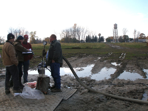 geologist and clients at a well site